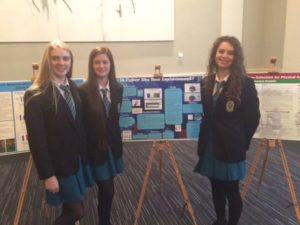 Amy Byrne, Conagh Fitzgerald and Maggie Nolan display their winning entry in the National Concert Hall.