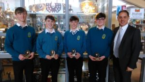 Senior Maths Quiz winners: Eoghan O Buachalla,Odhran Liston,Evan O Connor,David Broderick along with Mr Fleming who presented the prizes.