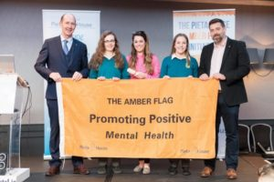 Frank Mulvhill and CEO Pieta House, Brian Higgins present the Amber flag to Eidin Dowling, Ms. Nolan and Maria Dwyer.